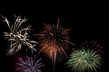Fireworks display viewed at night.  Several different colored fireworks exploding in the sky. Stock Photo - 3177091
