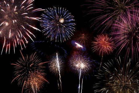 Multiple colored fireworks exploding in the sky. Stock Photo - 3206428