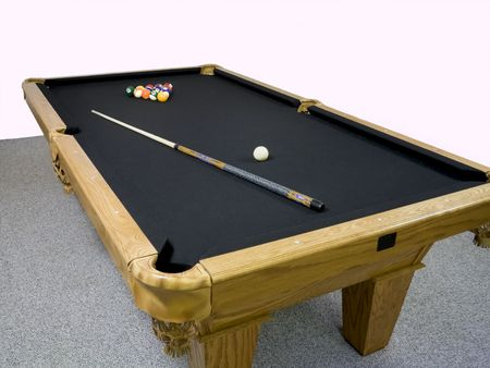 table top: Luxury black table top pool table with racked billiards and stick laying on top. Stock Photo