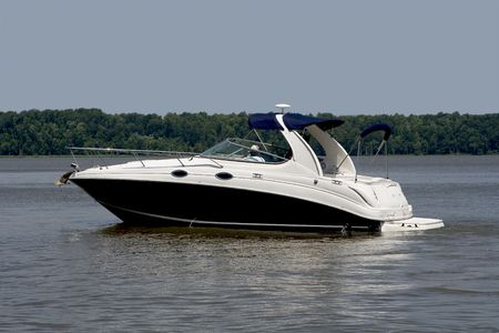 Luxurious pleasure boat slowly cruising down a river. Stok Fotoğraf