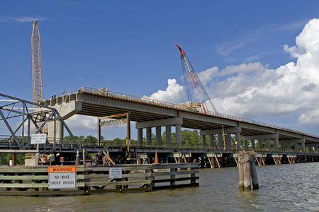 tremor: Old bridge next to new bridge under construction. Stock Photo