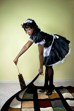 Maid being sneaky and sweeping under the rug.