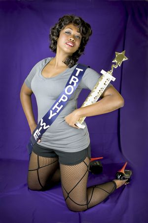 Attractive female holding trophy she won for being a
