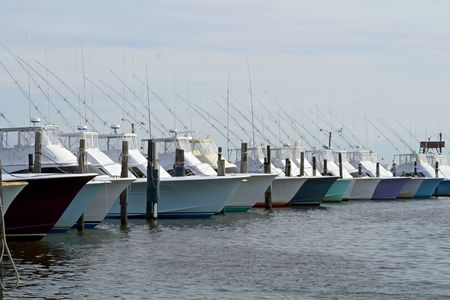 Row of deep sea fishing boat in a marina. photo