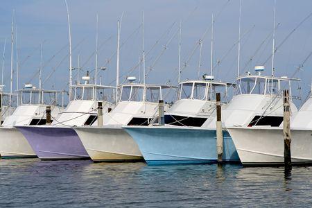Row of nice deep sea fishing boats in a marina. Stock Photo - 3588049