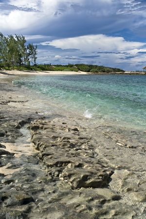 Beautiful tropical shoreline with clear blue and green water and rocky shore. Stock Photo - 3747347