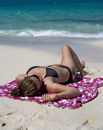 Young woman relaxing on a tropical beach. photo