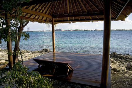 tropical shrub: Beach hut on a small and beautiful tropical island.