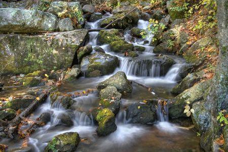 Autumn waterfall scene in the mountains. photo