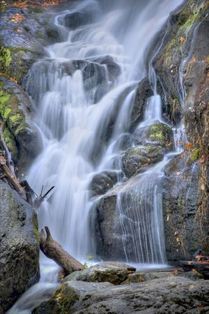 Beautiful autumn waterfall deep in the woods of a mountain. photo