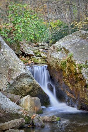 Beautiful waterfall in the middle of the forest during autumn. Stock Photo - 4167236