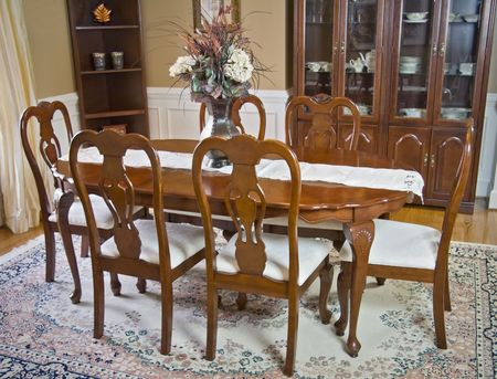 Luxury wooden dining room table and chairs. Фото со стока