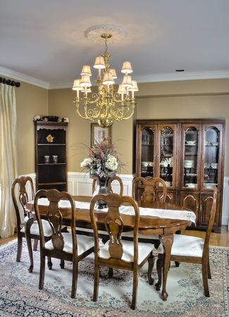 antique furniture: Luxury wooden dining room table and chairs in a modern home. Stock Photo