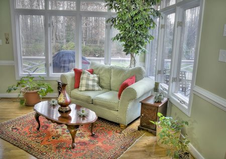 Interior of a corner room with tall windows and a view outside. Stock Photo - 4435784