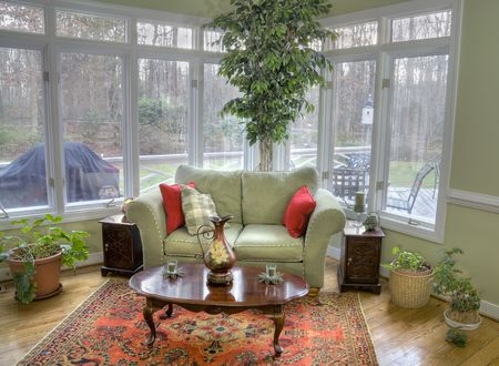 indoors: Interior of a corner room with tall windows and a view outside. Stock Photo
