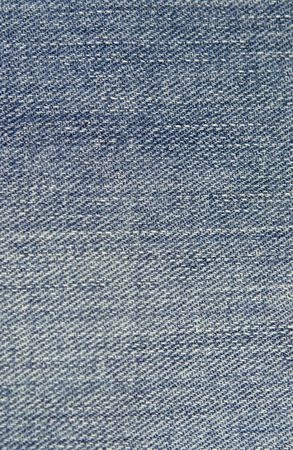 Close up textured background of blue colored jean material. photo