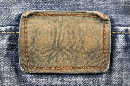 Schließen Sie im Alter von leer Leder-Patch auf der Rückseite eines Paares Jeans.