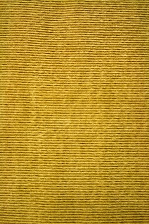 corduroy: Close up of orange colored corduroy fabric.