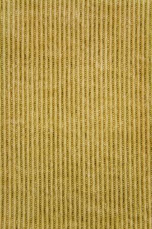 velvet dress: Close up of orange colored corduroy fabric material.