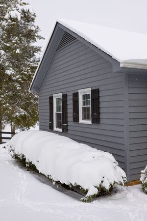 Snow covered gray colored residential home. Stock Photo - 4634095
