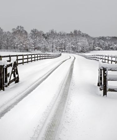 Snow covered driveway on a country farm. photo