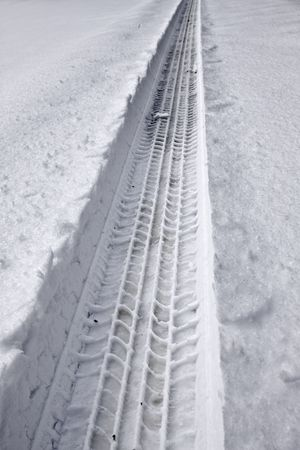 Snowy tire track from a car going through deep snow. Stock Photo - 4634086