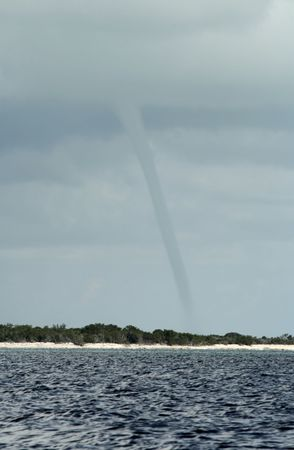Tornado touching down on land viewed from on water. Stock Photo - 4633970