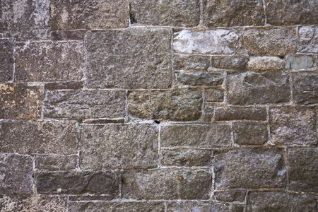 Old run down grungy stone wall background. Stock Photo - 6027952