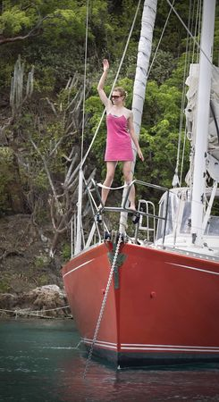 Young women having fun on the front of a luxurious sailboat. Stock Photo - 6043208