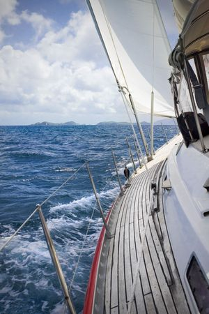 View from onboard luxury sailboat sailing through the tropics. Stock Photo
