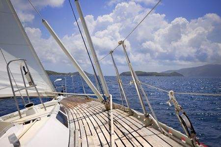 View from onboard luxury sailboat sailing through the tropics. photo