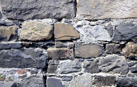 run down: Close up of old run down stone brick wall. Stock Photo