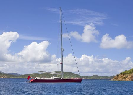 Large luxurious red sailboat anchored in the virgin islands. photo