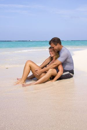 A couple enjoying a beautiful tropical beach. photo