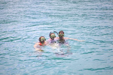 Family on vacation snorkeling in tropical water. Stock Photo - 6476440