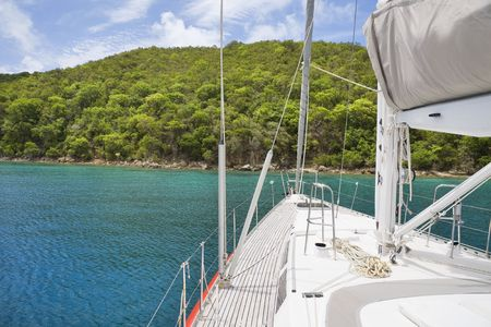 View from luxurious sailboat of beautiful tropical island. photo