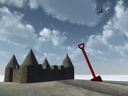 prompting: Sandcastle and red plastic spade prompting memories of childhood summers at the seaside