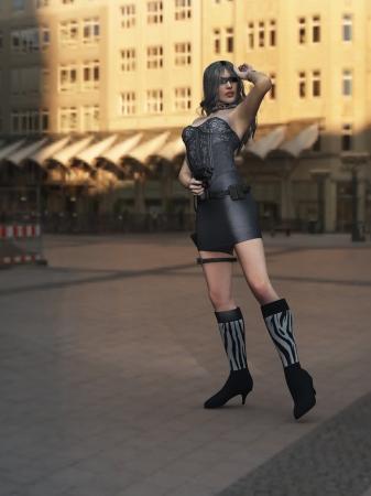 Female spy with gun and dark glasses posing in city square photo