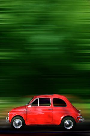 country side: Small red generic car speeding in the country side.