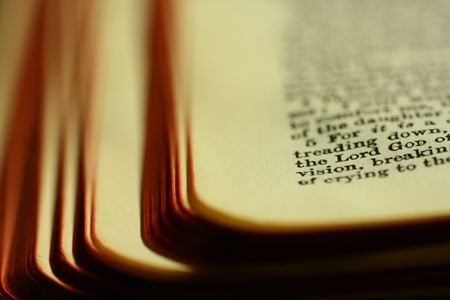 Closeup of a section of a bible. Low key shot with dramatic effects. Stock Photo - 703141