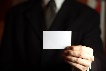 Business man presenting his card with copy space. Stock Photo - 703144