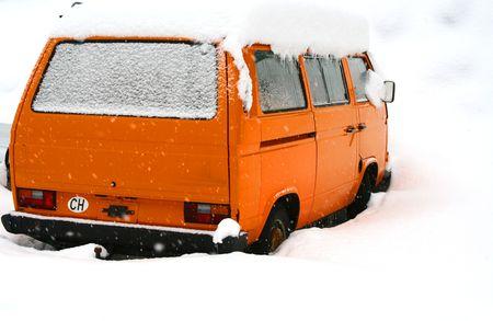 numberplate: Van covered deep in snow.