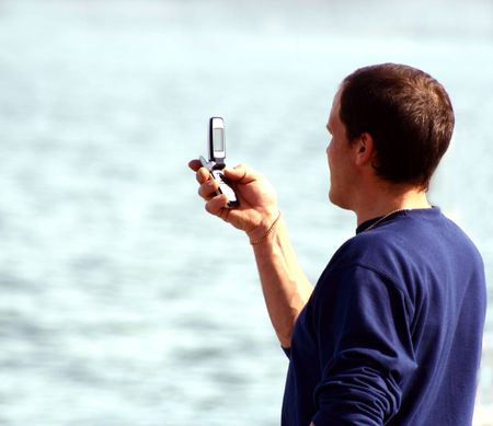 unrecognisable: Man checking his cell phone. Face unrecognisable.