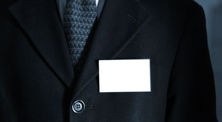 Business man presenting his card with copy space. Shot with blue filter. Stock Photo - 702345