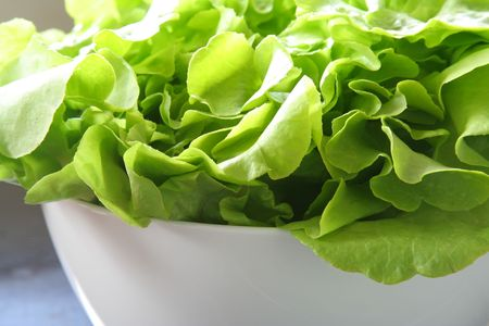 Green salad in a white bowl. photo