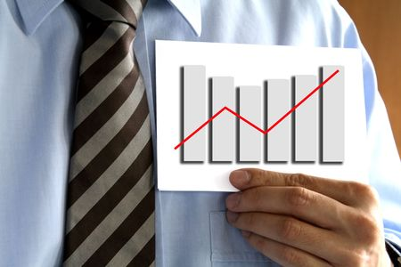Man in tie holding a paper with a graph. Stock Photo - 702322