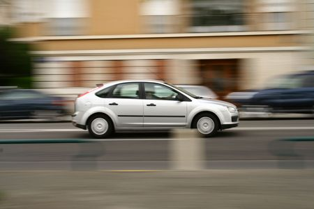 panning: Panning shot of a moving vehicle on the road.