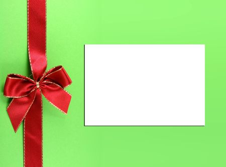 Present with red bow and white paper for text or messages. Concept: Christmas present.