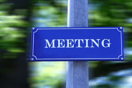 Street sign with text Meeting. photo