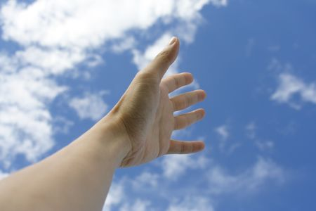 Outstretched hands reading for the sky. Concept: Asking God for help.